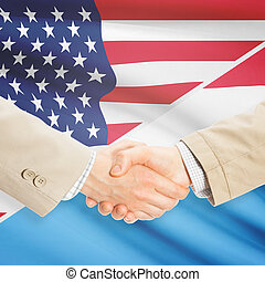 Businessmen handshake - United States and Luxembourg -...