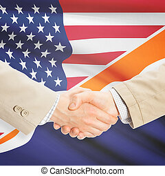 Businessmen handshake - United States and Marshall Islands -...