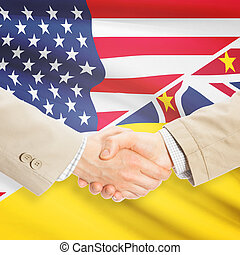 Businessmen handshake - United States and Niue - Businessmen...
