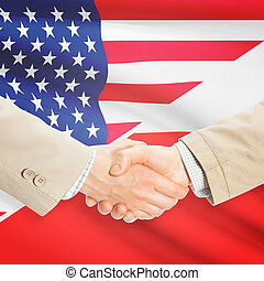Businessmen handshake - United States and Poland -...