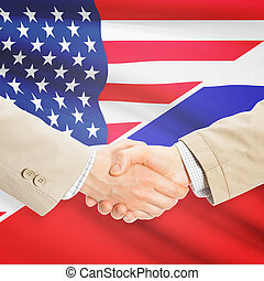 Businessmen handshake - United States and Russia -...
