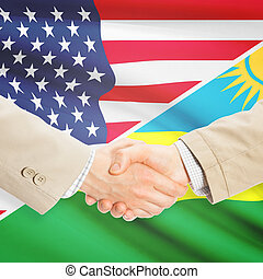 Businessmen handshake - United States and Rwanda -...