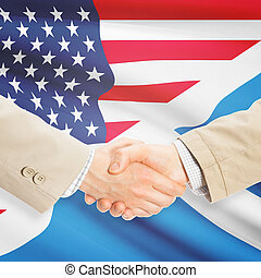Businessmen handshake - United States and Scotland -...
