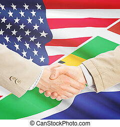 Businessmen handshake - United States and South Africa -...