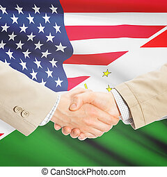 Businessmen handshake - United States and Tajikistan -...