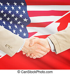 Businessmen handshake - United States and Tonga -...
