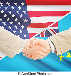 Businessmen handshake - United States and Tuvalu -...