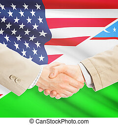 Businessmen handshake - United States and Uzbekistan -...