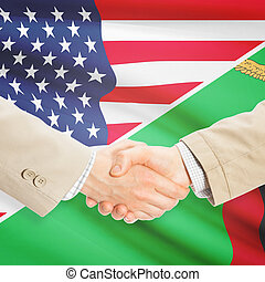 Businessmen handshake - United States and Zambia -...