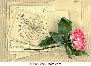 Old letters and dry rose flower Vintage postcards and...