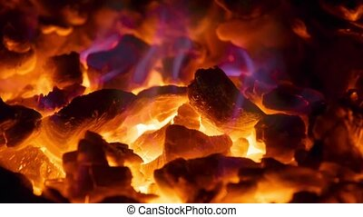 Glowing coals in the fireplace - Close-up glowing coals in...