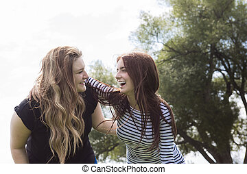 young girl friends together on walk