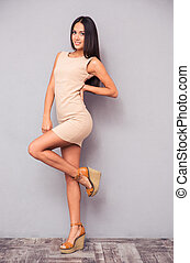 Attractive woman posing in dress