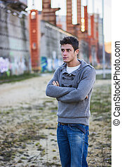 Attractive young man in urban environment
