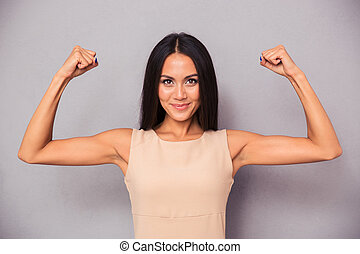 Happy elegant woman showing her biceps - Portrait of a happy...