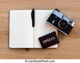 Russian Press card, open a Notepad, pen and a film camera, a...