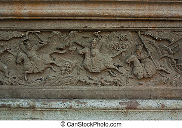 Rock Carvings on temple wall. - Rock Carvings on temple...