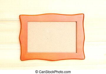 Wooden picture frame on wood background