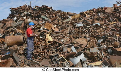 Recycling industry worker and metal - Metal recycling,...