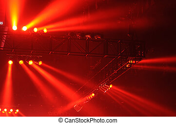 Red spot lights in a music concert