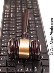 Gavel on computer keyboard