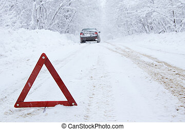 Emergency stop car on winter road in the countryside.
