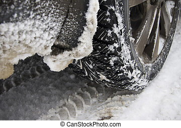 Winter tire on snow-covered road.