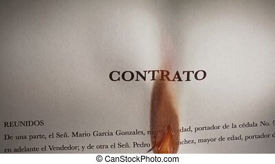 3 Closeup Of Contract In Spanish Burning On Fire - Closeup...