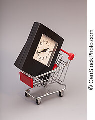 Shopping Cart with Alarm Clock on gray background