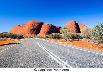 The Olgas and nearby roadscape in the Northern Territory,...