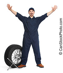 Car mechanic with a tire.