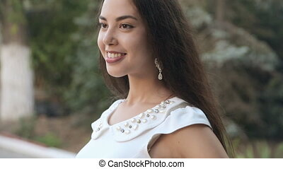 Pretty girl with long straight hair wearing a white dress...