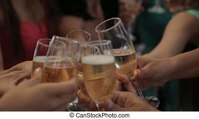 Beautiful women drinking champagne in a restaurant -...