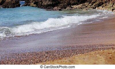 Sea waves on the sand