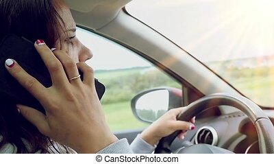 Attractive young woman talking on phone in car Slow motion...