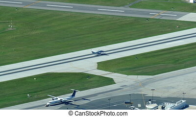 Propeller aircraft taking off from Billy Bishop Toronto City...