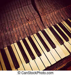 Keys of an antique piano, retro style photo.