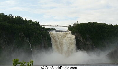 Montmorency waterfall near Quebec, Canada. The falls are 30...