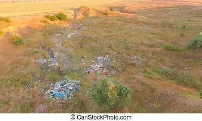 Garbage Scattered Around At Waste Landfill - Aerial view in...