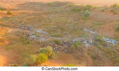 Waste Landfill With Garbage Scattered Around At Nature -...