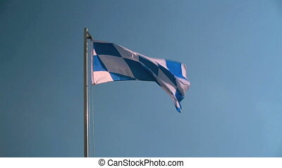 Bavarian flag in front of a blue sky with clouds