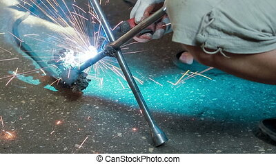 gas-welding works - Man is welding with gas torch