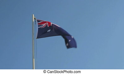 Australia flag in front of a blue background