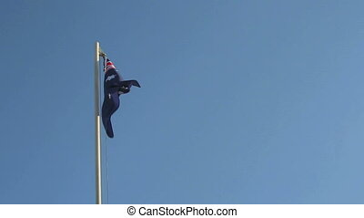 Australian flag in slow motion in front of a blue background