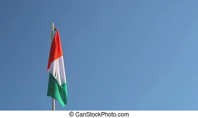 Ivory Coast flag in front of blue sky