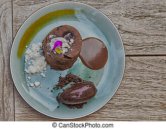 Delicious Desserts - spongecake with chocolate sauce and...