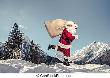 Santa Claus running with the bag of the presents