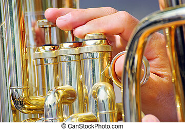 Musician playing tuba in street orc - Close up view of...
