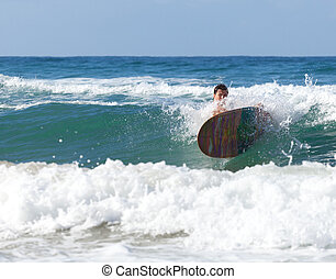 Surfer on longboard while it is falling in the waves in the...