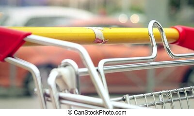 Woman hands takeing shopping cart at street 4k
